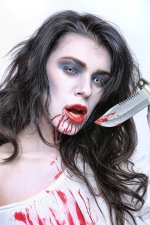 woman knife: Scary Horror Image of a Bleeding Psychotic Woman With Knife