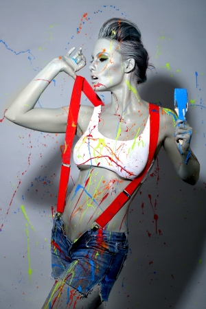Sexy Female House Painter Splattered with Latex Paint