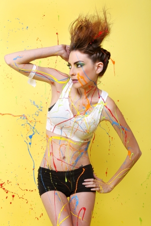 Beautiful Woman Splashed With Colorful Paint