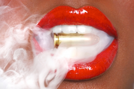 bullets: Beautiful Lips of a Woman With A Bullet and Smoke