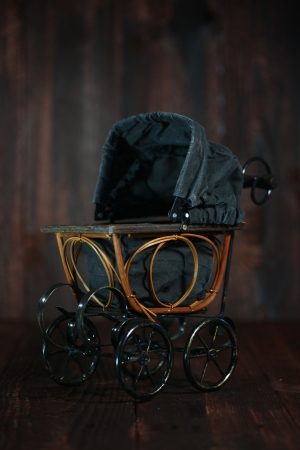 Antique Infant Baby Cradle on Grunge Wooden  photo