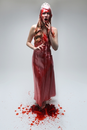 wet dress: Horror Image of a Woman Dripping in Blood Wearing Prom Dress