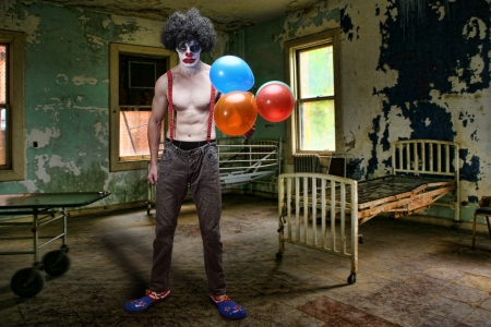 scary clown: Scary Evil Clown Inside Condemned Room With Hospital Bed