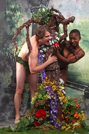 Playful Rendition of Adam and Eve With Added Theme of Interracial Unions Stock Photo