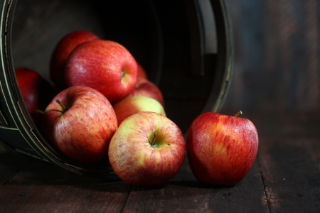 Rustic Barrel Full of Red Apples on Wood Grunge  Background