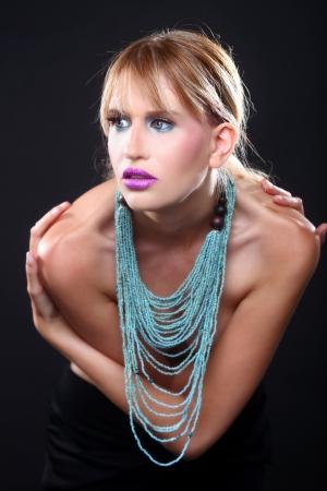 Beautiful Blonde Woman Wearing Makeup on Black Background