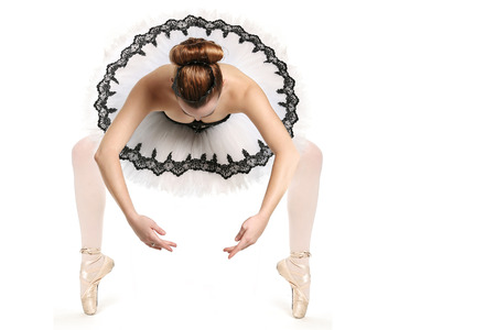 Stunning Ballet Dancer in Traditional Pancake Performance Outfit photo