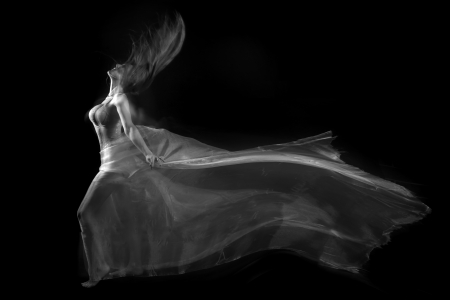 Artistic Image of Movement With Sheer Fabric and Long Exposure photo