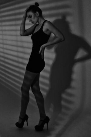 Dramatic Shadows and Lines of a Model in Monochrome