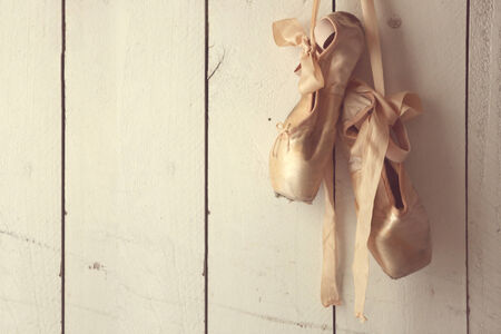 old shoes: Romantic Posed Pointe Shoes in Natural Light  Stock Photo