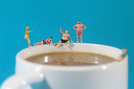 bizarre: Miniature Plastic People Swimming in Coffee
