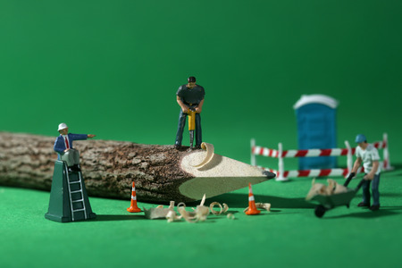 Miniature Construction Workers in Conceptual Imagery With Pencil