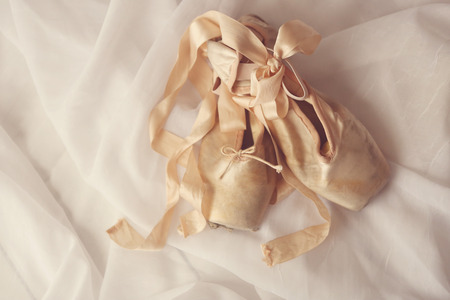 pointe: Romantic Posed Pointe Shoes in Natural Light  Stock Photo