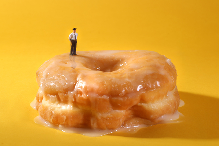 comedic: Miniature Police Officers in Conceptual Food Imagery With Doughnuts