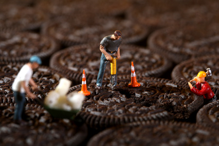 comedic: Miniature Construction Workers in Conceptual Imagery With Cookies