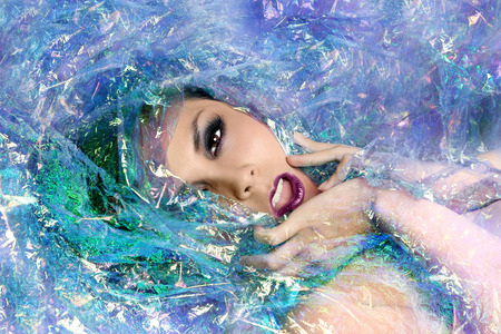 cellophane: Beautiful Beauty Image of a Woman Wrapped in Cellophane Stock Photo