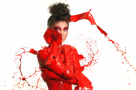 Beautiful Woman Covered in Bright Paint Splatter Standard-Bild