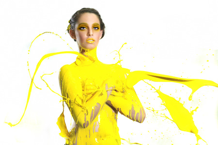 Beautiful Woman Covered in Bright Paint Splatter Reklamní fotografie