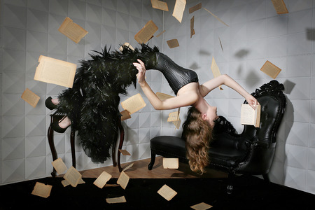 surreal: Levitation shot of a Woman and Her Favorite Book Stock Photo