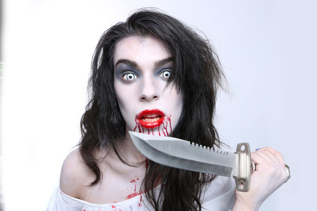 Bleeding Psychotic Woman in a Horror Themed Image Stock Photo