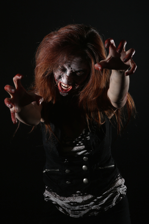 psychotic: Bleeding Psychotic Woman in a Horror Themed Image Stock Photo