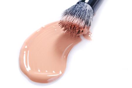 smudge: Liquid Beige Make Up Foundation on White Background Smeared