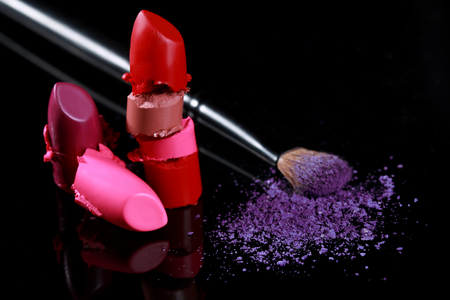 lip stick: Sliced and Cut Lipstick Pieces Stacked Together With Eyeshadow