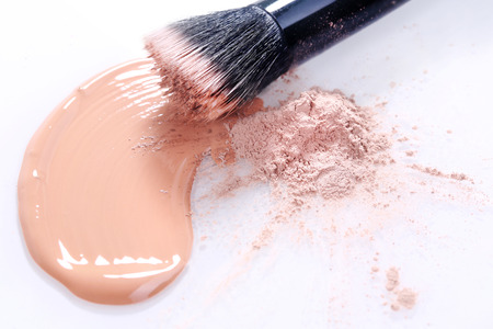 touch base: Liquid Beige Make Up Foundation on White Background Smeared