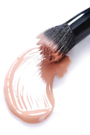 Liquid Beige Make Up Foundation on White Background Smeared
