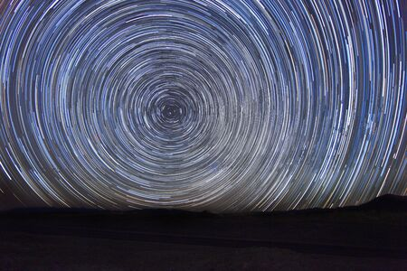 astral: Vortex Night Exposure Star Trails of the Sky Stock Photo