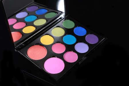 Bright Color Palette of Various Eyeshadows on Black Background Banco de Imagens