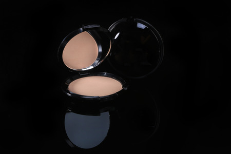 compact: Compact Pressed Powder on Black Background