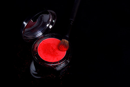 compact: Red Eyeshadow With Brush and Loose Powder on Black Background