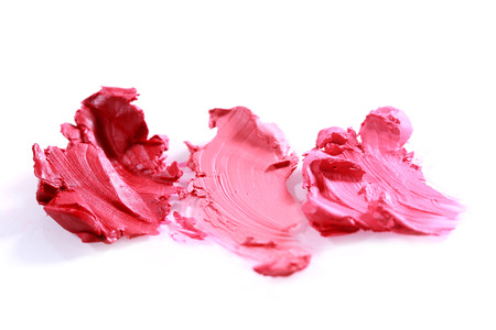 red lip: Colorful Smeared Lipstick Colors on White Background Stock Photo