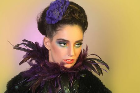 fashion make up: Beautiful Girl in High Fashion Make Up and Feathers