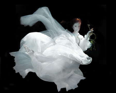 floating: Floating Woman Underwater Wearing White Gown