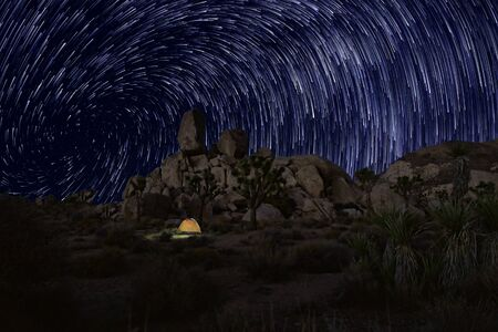 time lapse: Night Exposure Star Trails In Joshua Tree National Park Stock Photo