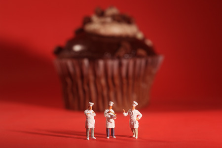 rendition: Funny Rendition of Miniature Chefs With Cupcake Stock Photo