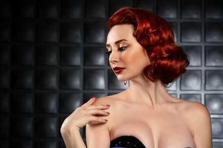 red haired: Red Haired Pinup Fashion Model on Styled Set