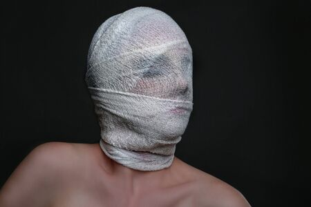 seeping: Dramatic Beauty Concept of Heavy Makeup Seeping Through Gauze