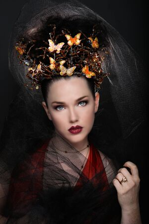 Stunning Fashionable Woman Wearing High End Head Piece photo