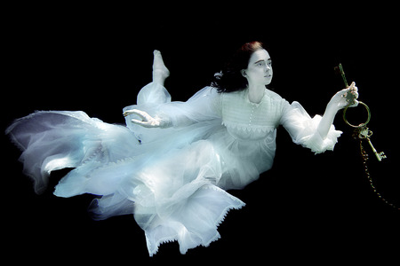 Floating Woman Underwater Wearing White Gown