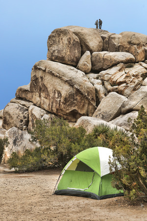 daredevil: Campers Repelling and Rock Climbing in Joshua Tree National Park Stock Photo