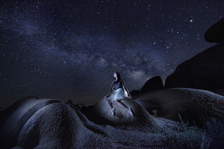 astral: Ballet Dancer Alone Under the Milky Way in Joshua Tree National Park USA Stock Photo