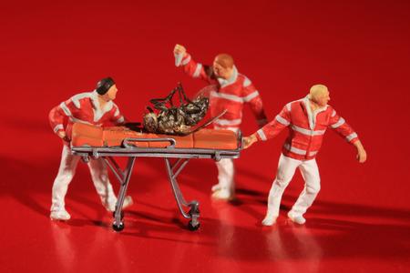 Humorous Posed Miniature Paramedics Treating the Honeybee Crisis Stock Photo