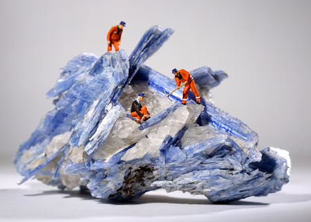 Miniature People Working in the Mining of Minerals Field
