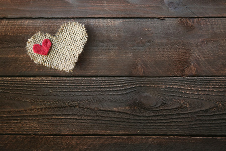Burlap Heart on a Wooden Background With Copy Space