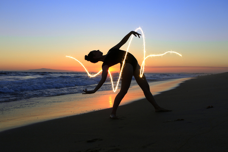 Beautiful Young Dancer at the Beach During Sunset