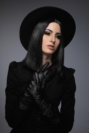 High Fashion Model Wearing Black Hat and Leather Gloves