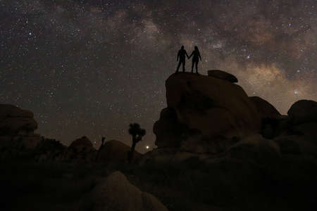 Happy Couple Silhouette Under the Stars at Night